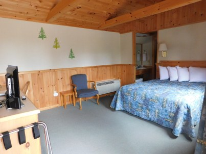 Wiscasset Woods Lodge room with knotty pine interior