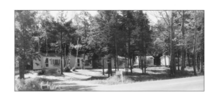 Photo of cabins at Wiscasset Woods Lodge circa 1935. Our hotel has been welcoming guests to Maine for over 100 years.