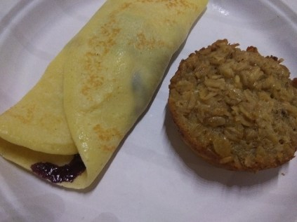 Blueberry crepes and baked oatmeal on a plate. One of many breakfast specialties at Wiscasset Woods Lodge.