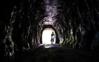 Riding through a tunnel on the Elroy-Sparta State Trail