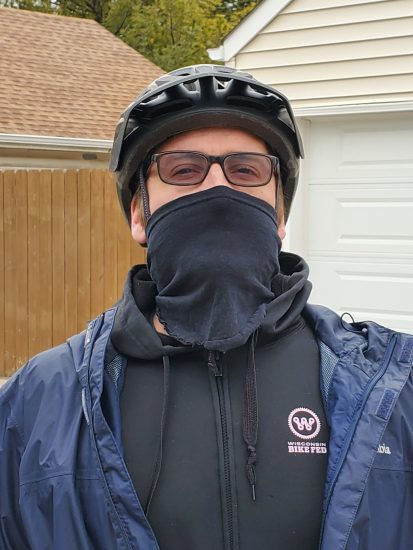 cyclist wears no sew mask before a ride