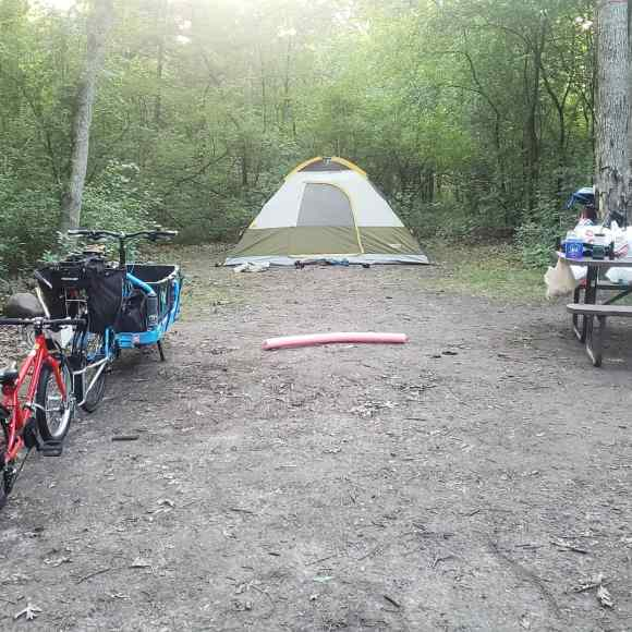 bikes and tent on campground