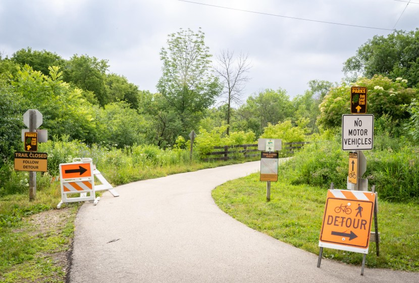 Trail closed and detour signs on Oak Leaf Trail