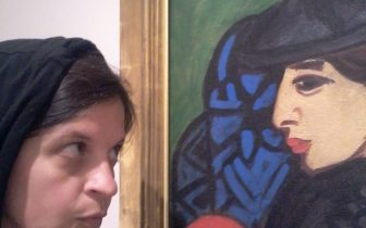 woman looks at painting