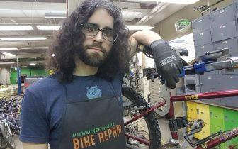 person in bike repair shop