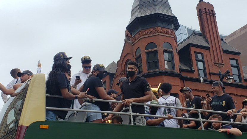 giannis on a bus during parade