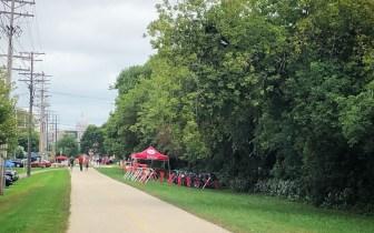 a tent and bike racks along the trail
