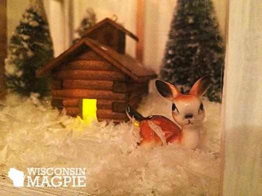 miniature deer and cabin