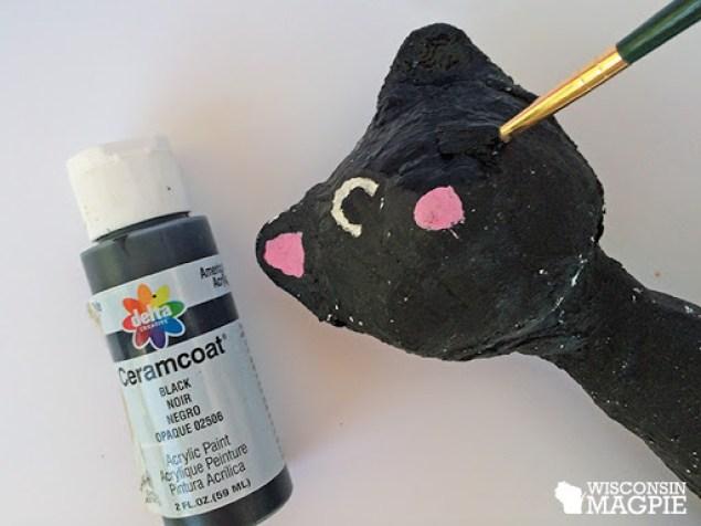 covering a paper mache cat in jute twine