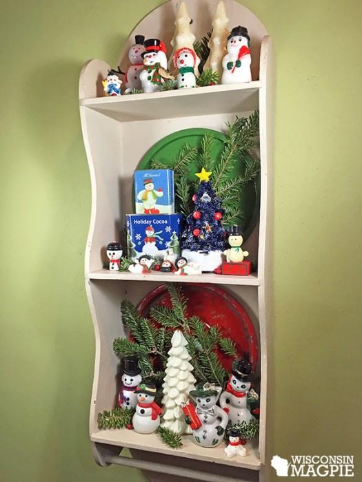 vintage snowmen on a shelf