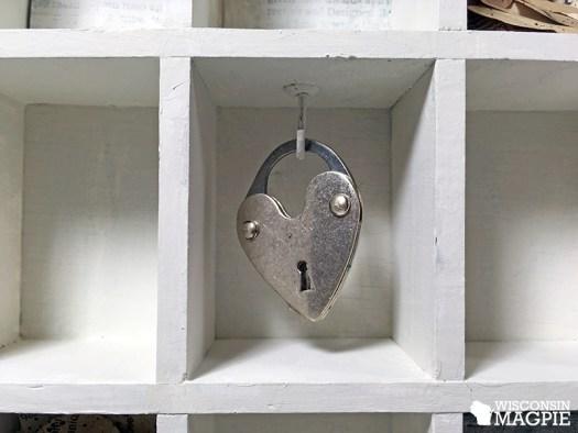 milk-painted curio cabinet