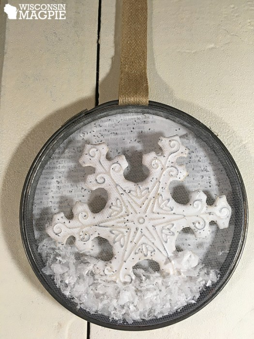 embroidery hoop with snowflakes inside