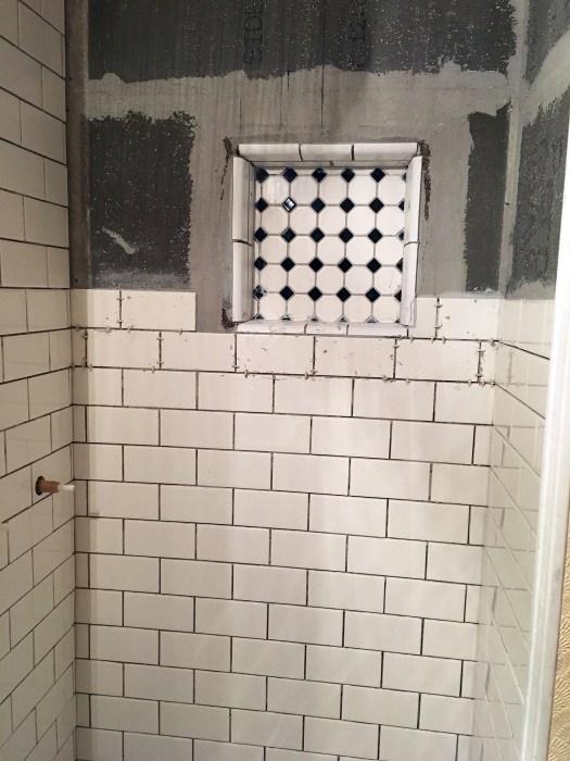 shower stall after tiling inset shelf