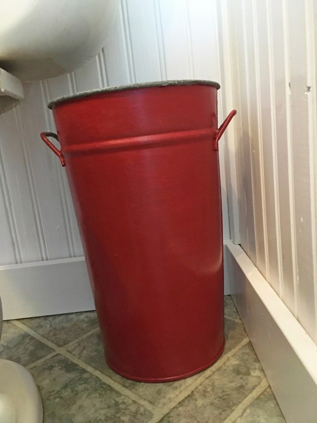 small red bathroom garbage can