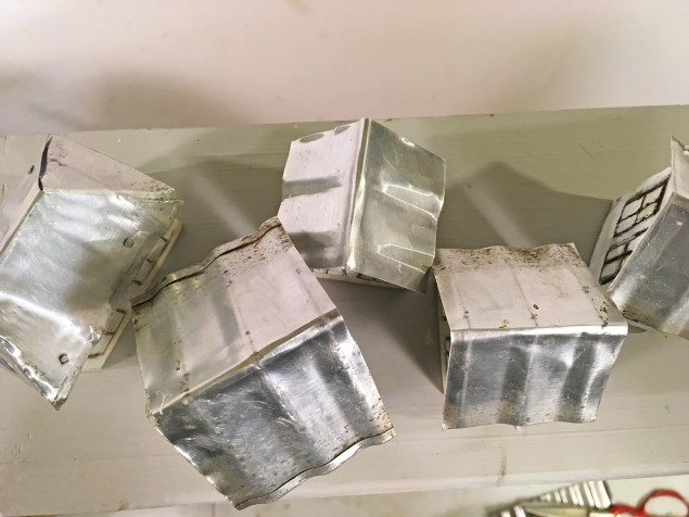 overhead view of corrugated tin roofs on mini houses