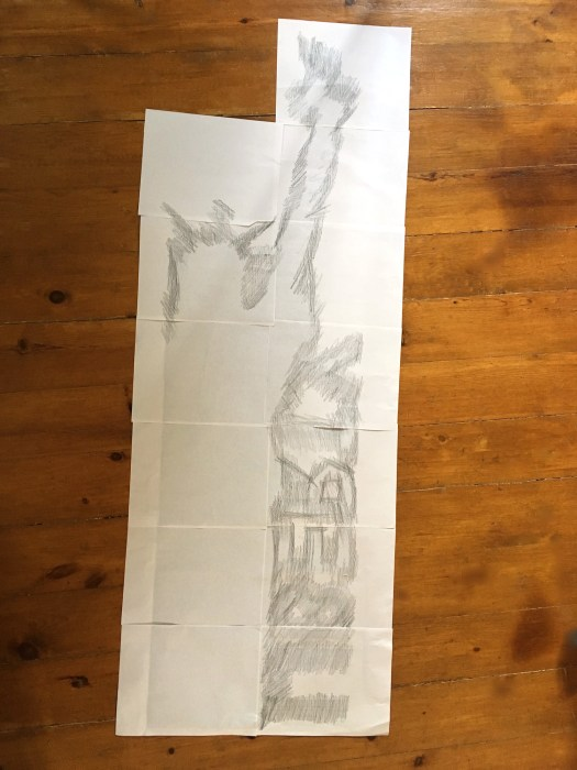 Back side of Statue of Liberty printout, showing pencil scribbled over outlines of silhouette, to be traced and transferred onto signboard