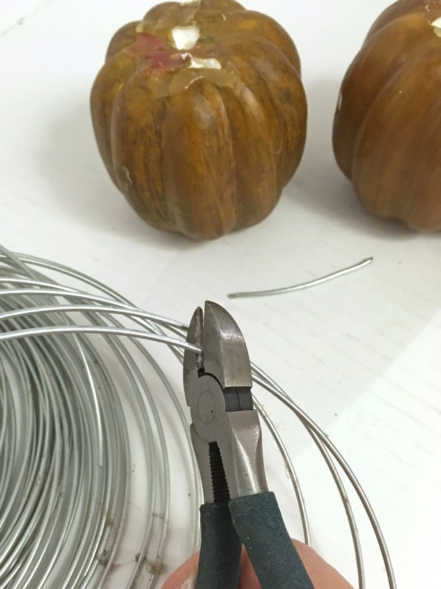 Wire cutters snipping a piece of wire off a coil