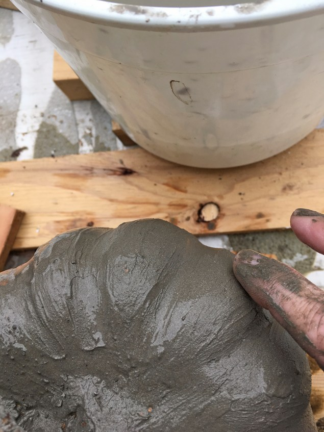 Smoothing out cement skimcoat on decorative pumpkin