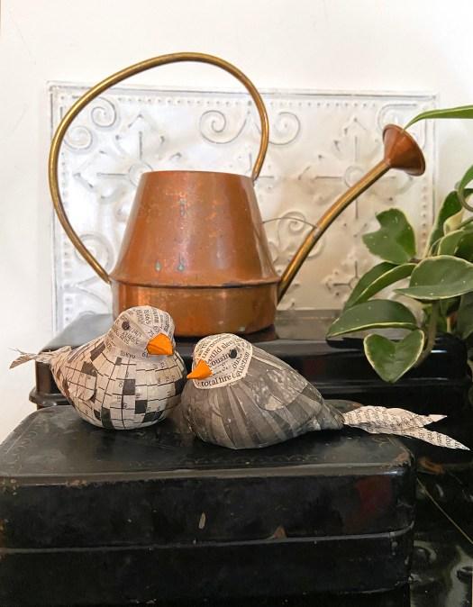 decoupaged newspaper birds in spring display
