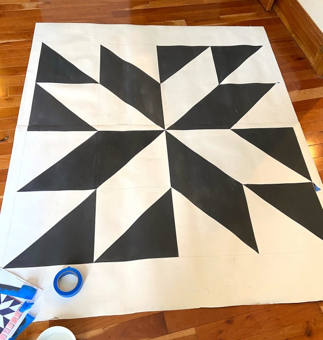 Barn quilt patio rug with a white border
