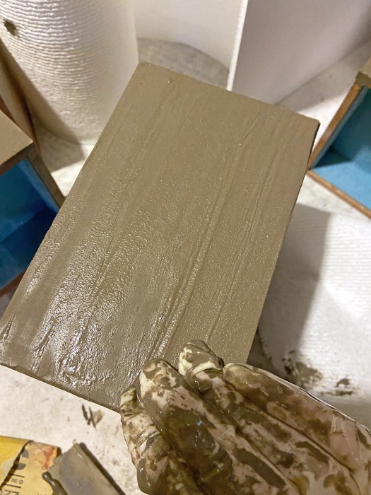 jewelry box drawer with watery coat of cement being applied