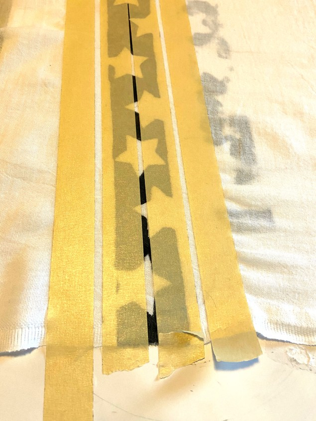 strips of masking tape parallel to each other in preparation for painting stripes