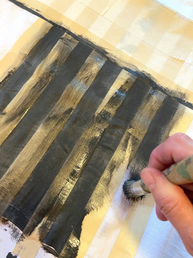 apply chalk paint on fabric with a stiff-bristled brush