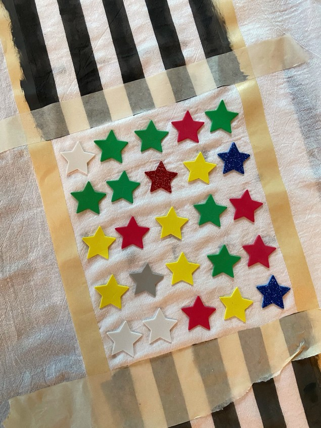foam sticker stars adhered to flour sack dishtowel