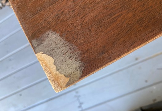 Adding wood filler to chipped veneer