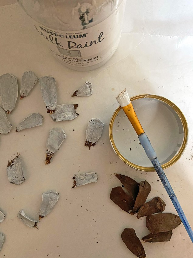 Pinecone scales being painted white