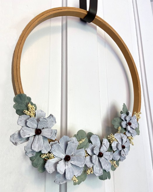 Embroidery hoop wreath with pinecone flowers