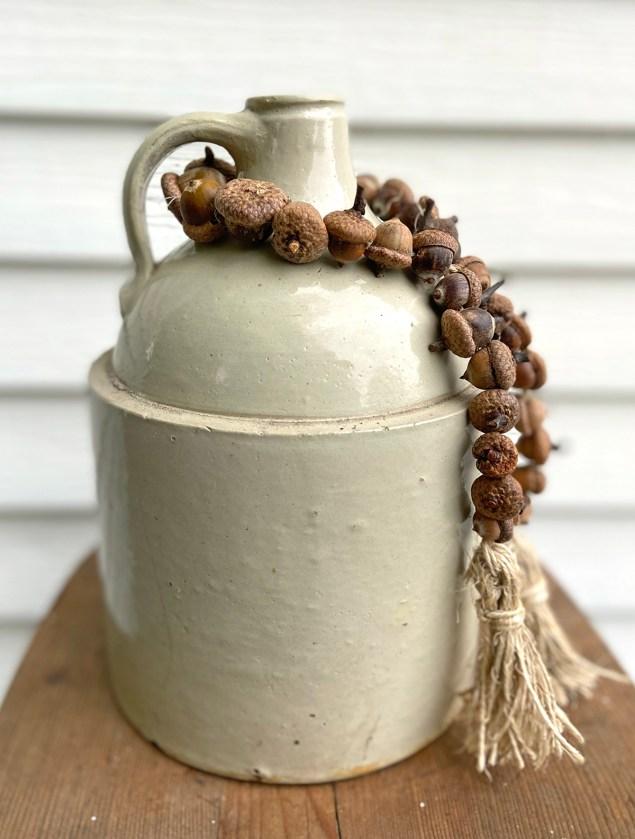acorn garland wrapped around a vintage jug