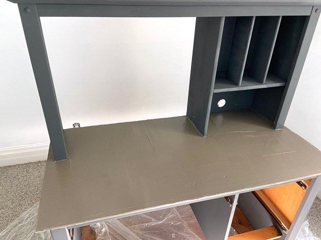 industrial farmhouse style desk after the first coat of cement had been applied to the desktop