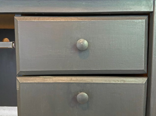 closeup of the two desk drawers showing a 1/8-inch gap between them on the left and a 1/4-inch gap between them on the right