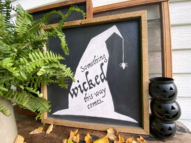 "DIY Halloween sign. Silhouette of witch's hat with ""Something wicked this way comes"" typed on it."