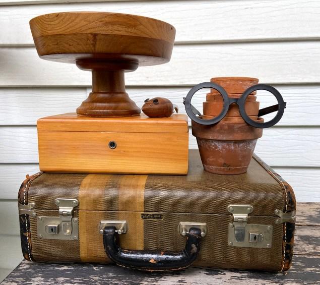 thrift haul; wooden pedestal bowl, wood box, vintage suitcase, stack of terra cotta pots, plastic Harry Potter glasses