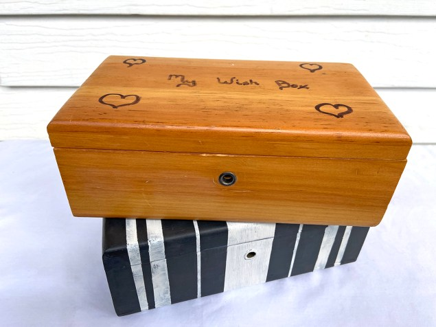 wooden box stacked on top of black and white striped box