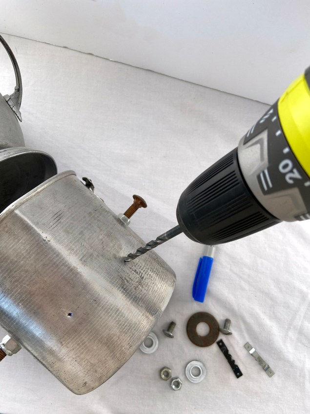 Drilling holes into Robot Frankenstein's head where his eyes will be attached