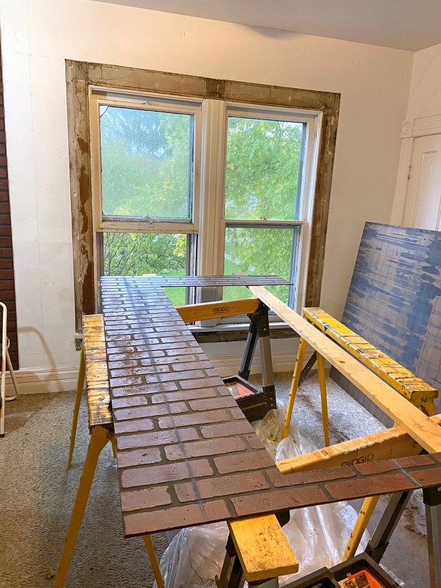 cutting faux brick paneling to go around a window