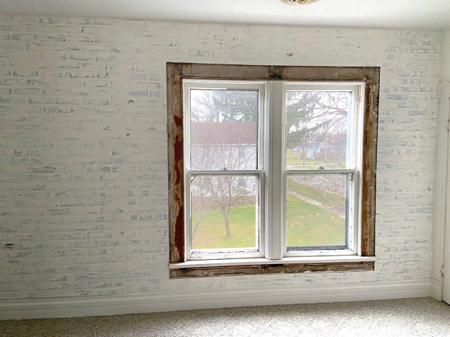 faux brick wall made from paneling, coated with a German schmear of joint compound and painted with watered down paint