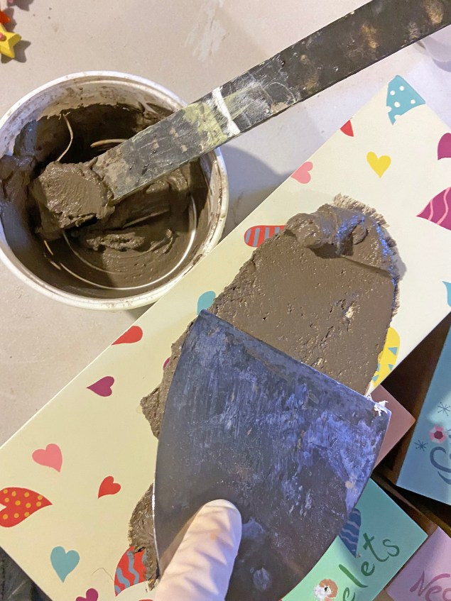 mixing the cement skim coat for the jewelry box makeover