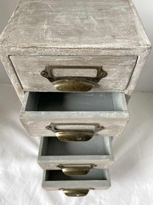 concrete apothecary cabinet with drawers open