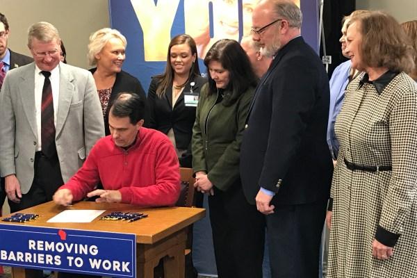 Gov. Walker signing the eNLC