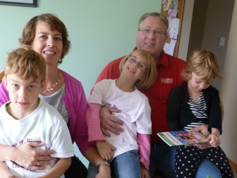 The Allens near Oconomowoc with their three children (left to right): Henry, 7, Natalie, 5, and Claire, 3.
