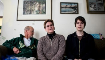 Brian Sorensen (left), his wife, Lisa Nerenhausen, and son, Parker Sorensen, at their home in Appleton, Wis., on December 20, 2013. Lisa and her husband are losing coverage under BadgerCare, as part of the approximately 70,000 people that will be forced to move on to the private health care exchange. But their son, Parker, stands to gain coverage from the change, as he is among the 80,000 or so poor childless adults who may qualify for coverage under the new system.