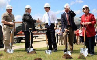 City and county officials, as well as Gov. Scott Walker, take turns breaking ground at Ashley's Whitehall expansion in 2012. The company stands to receive $675,000 for adding and retaining jobs at this plant.