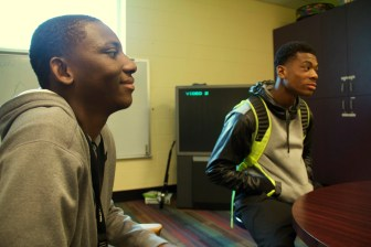 Illa Daff, 20, left, and Terrell James, 16, right, discuss their experiences with guns in and around Madison.