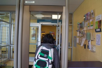 A teen passes through the metal detector at the Dane County Boys and Girls Club in Fitchburg.