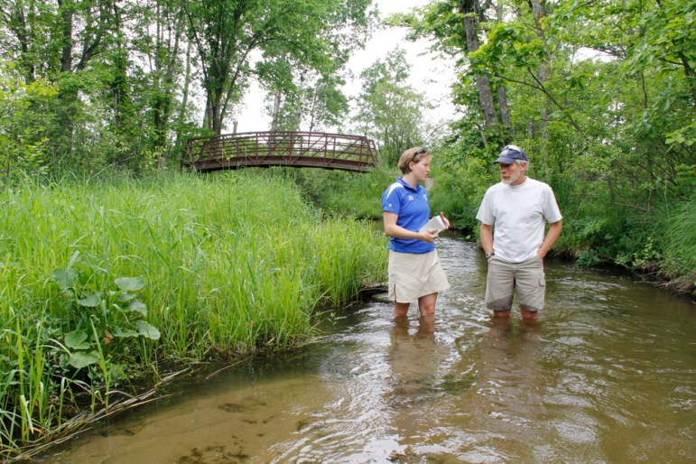 Reporting intern and UW-Madison journalism master's student Kate Prengaman talks to groundwater expert George Kraft in the Little Plover River in June 2013.