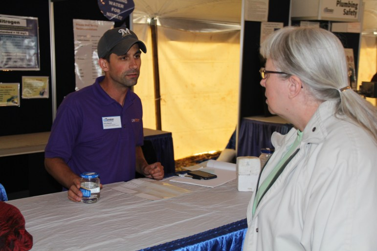 """Kevin Masarik, a groundwater education specialist at the University of Wisconsin-Stevens Point's Center for Watershed Science and Education, is seen here at Wisconsin Farm Technology Days near Sun Prairie in August. """"I don't think we have fully realized what the extent of nitrate (in groundwater) is throughout Wisconsin yet,"""" he said."""